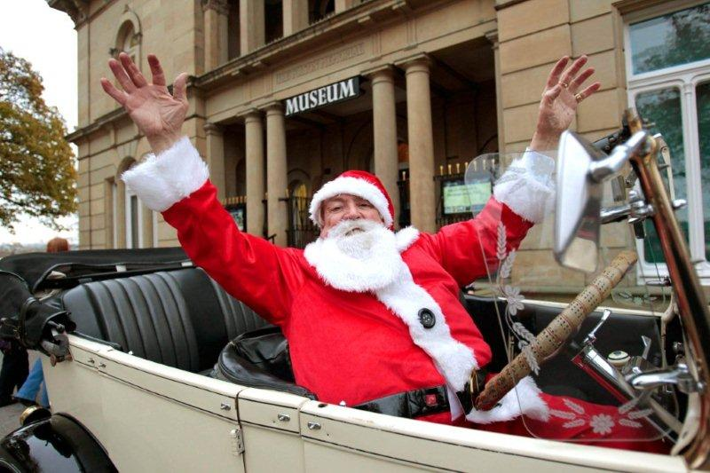 Father Christmas Arriving In His Vintage Car